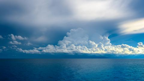 Deep blue Atlantic Ocean with clouds