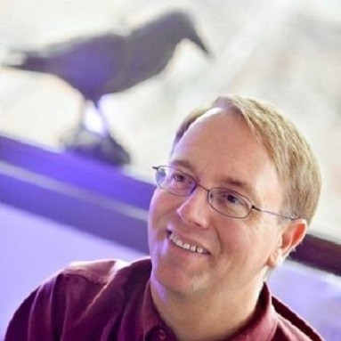 Dr. Kevin Omland with bird in background