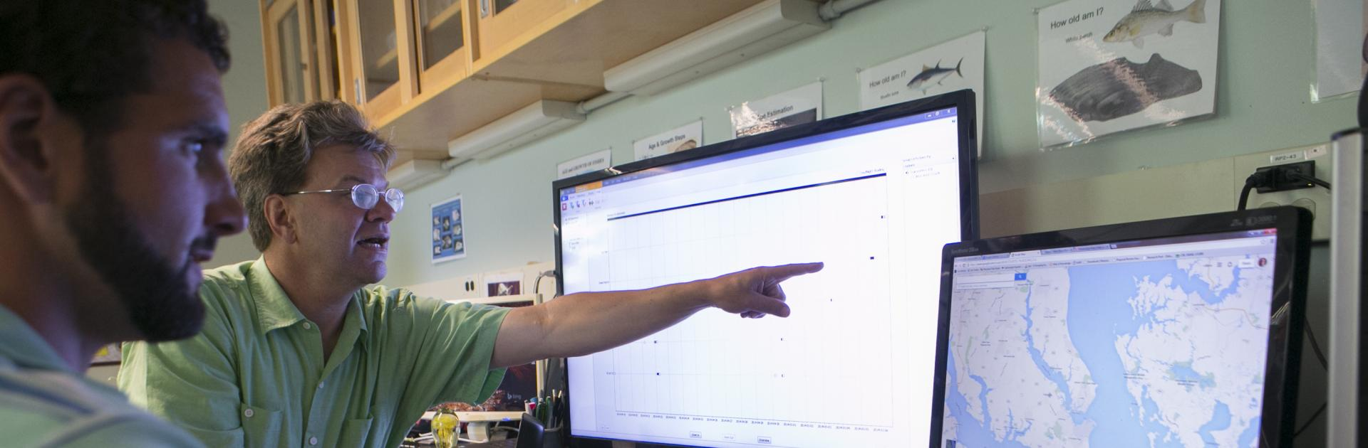 Professor Dave Secor points on rockfish migration patterns on a computer monitor.