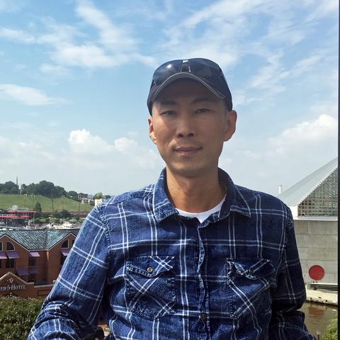 headshot of Kui Wang