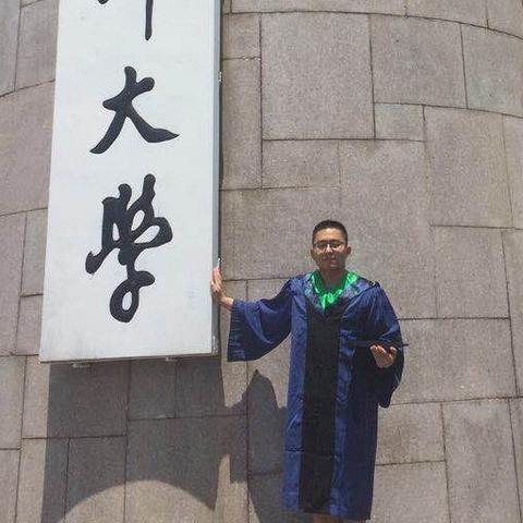 Tao Wang in graduation robes
