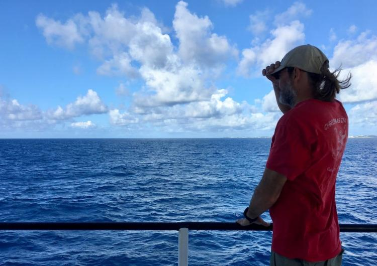 Scientist Michael Gonsior on deck of research vessel looking out onto the deep Atlantic Ocean