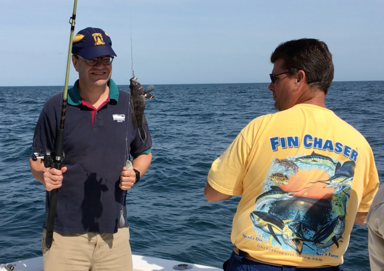 David Secor catches a black sea bass